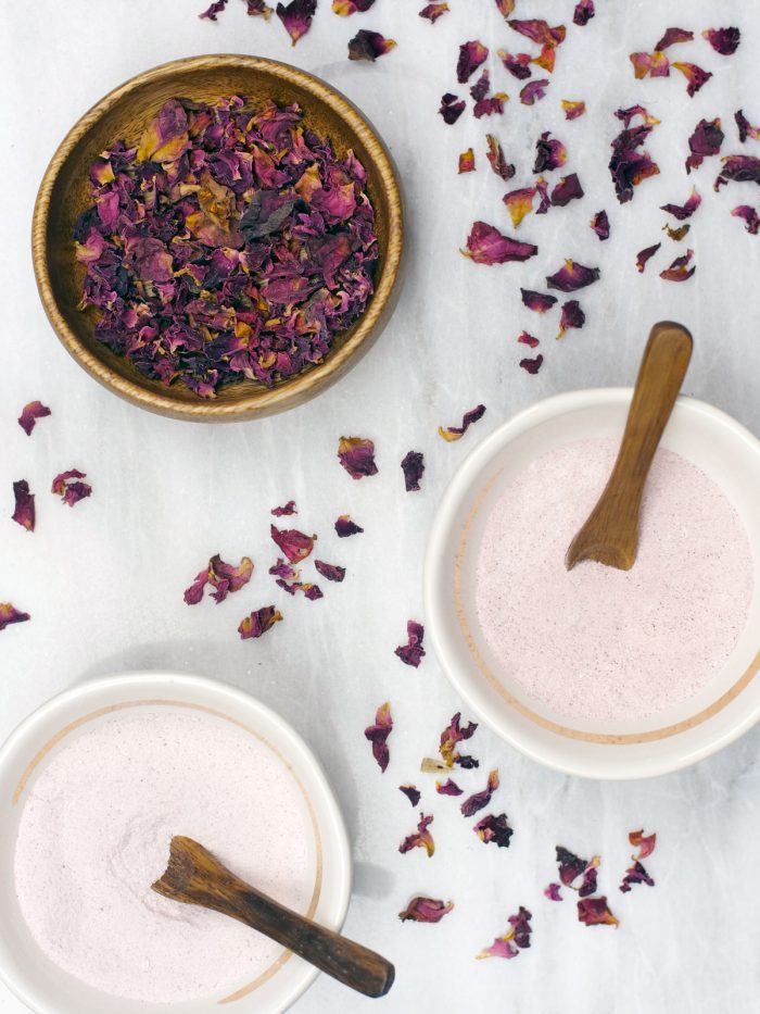 Ingredients for homemade bath bombs with rose petals