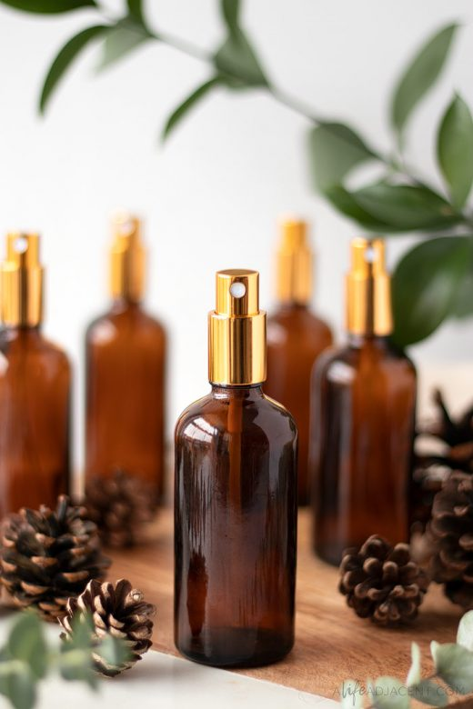 Christmas essential oil room spray on wood tray