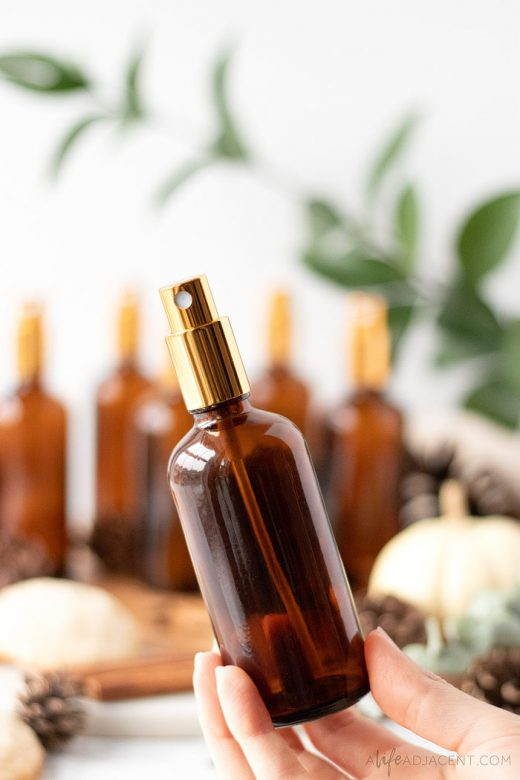 DIY holiday room spray in amber glass bottle